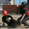 Beverly Kiki McKenna slides safely into home against Marblehead's Pelkey (no first names on roster) during yesterday's game held in Beverly Photo by Deborah Parker/May 21, 2009