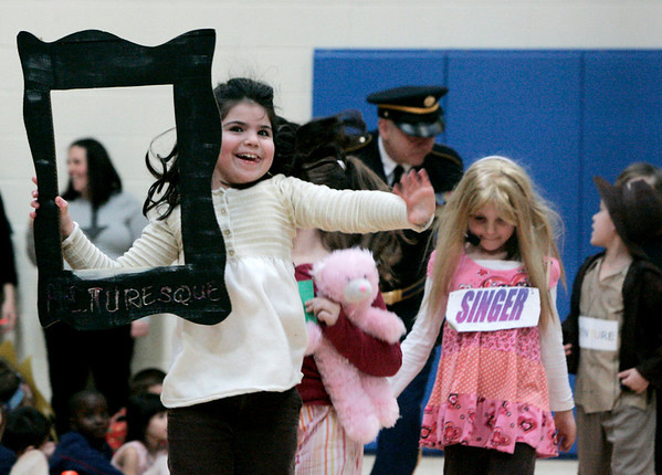 Salem: Mayri Ross, a second grade student at Carlton Elementary leads her class in the Vocabulary Parade Wednesday. Students picked a word to dress up in, while teachers made their students guess what word they were dressed as. Photo by Deborah Parker/Salem News Wednesday February, 11, 2009.