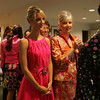 Amanda Kelly of Braintree and Susan Darbyshire of Danvers wait their turn to walk the catwalk during the Lorraine Roy Designer Collections and Bridal Boutique's Pink Pumps and Polka Dots fashion show held at Putnam Farm in Danvers Wednesday evening. Photo by Deborah Parker/August 19, 2010