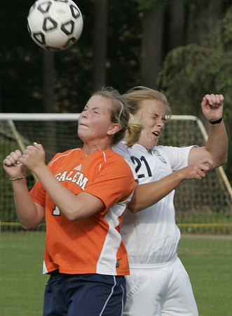 Wenham: Salem State's Erin O'Brien heads the ball against Gordon College's Liz Cheesman during their game Thursday afternoon.<br /> Photo by Deborah Parker/Salem News Thursday, September 25, 2008