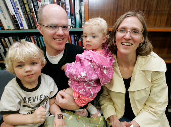 """The Edgar-Smith family of Lynn, from left, Cassin, 3, Devyn, Julia, 1, and Shelly, enjoy the """"Pirates Night"""" family night program at the Swampscott Library Tuesday. The event included live pirate performers along with a temporary tattoo to wear through the evening. Photo by Deborah Parker/July 7, 2009."""