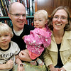 "The Edgar-Smith family of Lynn, from left, Cassin, 3, Devyn, Julia, 1, and Shelly, enjoy the ""Pirates Night"" family night program at the Swampscott Library Tuesday. The event included live pirate performers along with a temporary tattoo to wear through the evening. Photo by Deborah Parker/July 7, 2009."