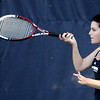Gordon College's Emily Hamilton competes in a doubles game against Bridgewater State College at Gordon yesterday afternoon. Photo by Deborah Parker/September 3, 2009