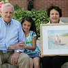 Julianne LeBlanc, 8, of Peabody, a second grader at Brown Elementary School sits with her grandparents Paul and Ruth Mowder. LeBlanc wrote a poem as part of an assignment in class and the poem won third place in a poety-art show. Her grandmother decided to create a painting based on her poem showing Julianne and her grandfather at the beach. Photo by Deborah Parker/May 6, 2010
