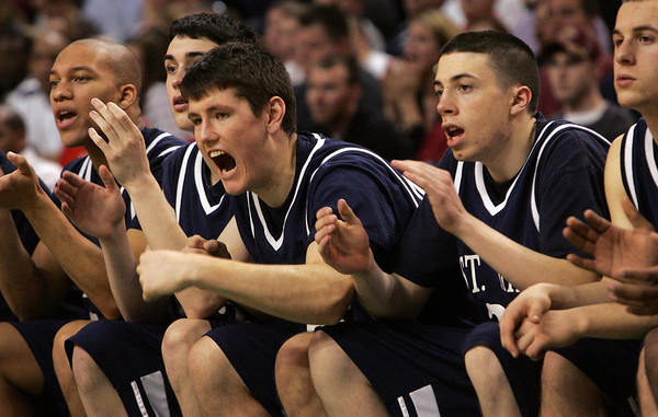 St. John's bench reacts as they scored against Central Catholic with just seconds left in the game during last night's Division 1 Sectional Finals at the Garden Friday evening. Photo by Deborah Parker/March 5, 2010