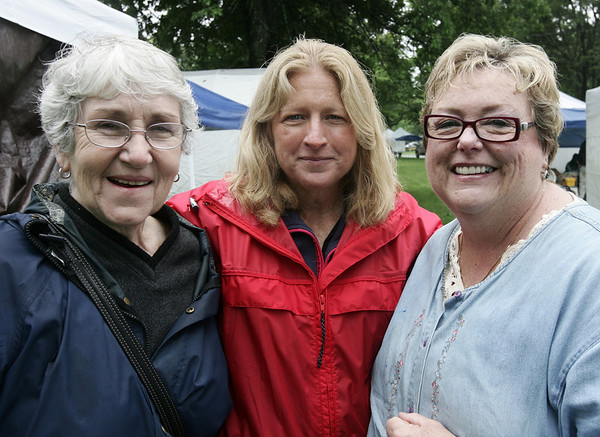 From left, Ellie Norris, Nancy Woodworth and Sandy Galanis, all of Ipswich, take a break from their stands to pose for a picture during the Olde Ipswich Days Arts and Crafts Fair Friday afternoon. Photo by Deborah Parker/July 24, 2009