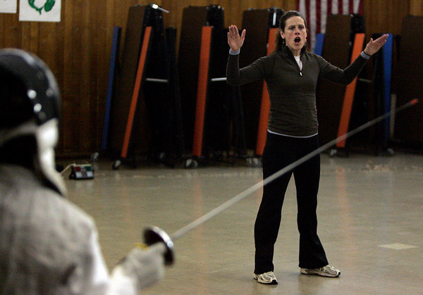 Peabdoy: Fencing coach, Molly Sullivan Sliney lays out the rules of a drill during practice held at Higgins Middle School Wednesday evening. Sullivan is a former Olympian and partner coach, Jane Carter is a Pan American games gold medalist. Photo by Deborah Parker/Salem News Wednesday, December 17, 2008.