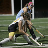 Bishop Fenwick's Meg Delory is defended by Medfield's Stephanie Buff during yesteday's game under the lights held at Bishop Fenwick in Peabody. Photo by Deborah Parker/october 18, 2010