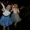 Samantha Jones, 7, left and Sarah Robinson, 5, of Beverly dance to music playing on a float during last night's Halloween Parade in down town Salem. Photo by Deborah Parker/October 1, 2009