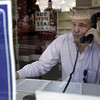 Beverly : Volunteer Bill English of Beverly worked the phone Saturday while at the Republican campaign office on Cabot Street in Beverly. Photo by Deborah Parker/Salem News Saturday, October 18, 2008