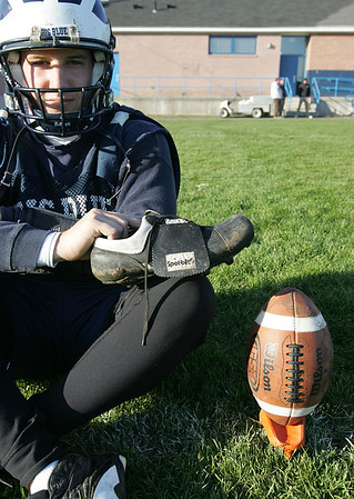 Matt Barbuzzi gets a lot of credit for being the Swampscott football team's quarterback, but he also happens to be a solid placekicker. He also uses an unusual style to kick, with a shoe that is specially designed for kicking in a straight-on manner. Photo by Deborah Parker/October 29, 2009
