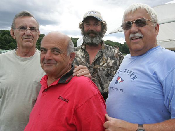From left, Bill Lebron of Ipswich, Ron Fortunato of Beverly, Venny Scherzinger of Peabody and the Commodore, Donald O'Connor of Beverly, attend a bbq at the Bass Haven Yacht Club in Beverly in honor of its 100th anniversary Thursday evening. Photo by Deborah Parker/July 2, 2010