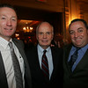 Retiring Police Chief Bob St. Pierre, middle, poses with incoming Police Chief Paul Tucker and Captian Brian Gilligan during St. Pierre's retirement party at the Hawthorne Hotel. Photo by Deborah Parker/September 30, 2009