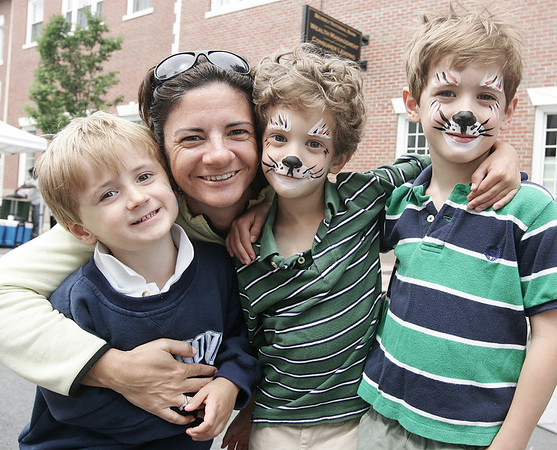 Lauren Harrison of Beverly poses with her three sons, William, 3, Aiden, 5, and Colin, 5 while attending the Beverly Arts Festival on Cabot Street Saturday. Along with art vendors there were games for kids, a dj, and food. Photo by Deborah Parker/June 20, 2009.