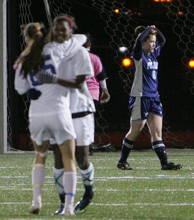 Peabody's Sarah Gravel reacts after Acton-Boxboro scores another goal in Division 1 North soccer final held at Fraser Field in Lynn Monday evening. Photo by Deborah Parker/November 16, 2009