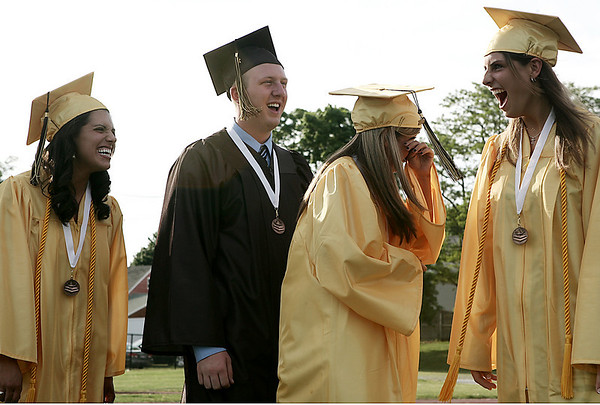 Peabody: Bishop Fenwick seniors, from left Vanessa Poirier, Richard Pelosi, Molly Hagerty and Lauren DiCarlo share mixed emotions as they prepare to take their seats during the start of graduation Friday. Photo by Deborah Parker/May 22, 2009
