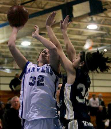 Danvers: Danvers' Taylor Cross shoots on hoop against Wintrhop's K Mallios (no first names on roster) during yesterday's game held at Danvers High School. Photo by Deborah Parker/Salem News Friday, February 6, 2009.
