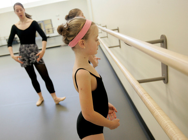 Marblehead: Boston Ballet dance teacher, Jennifer Markham teaches Emma Grazado the correct position for her shoulders during dance class at the Boston Ballet School located in the new Marblehead YMCA.  Photo by Deborah Parker/Salem News Thursday, February, 12, 2009.