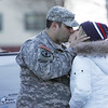 Tom Tognazzi kisses girlfriend Ashley Dias before boarding a bus to join the Massachusetts National Guard 101st Field Artillery Unit, based at the Danvers Armory, as they deployed today for training as they head to Afghanistan. Photo by Deborah Parker/January 6, 2009.