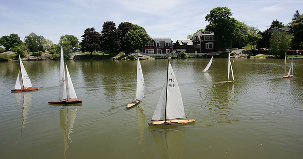 """On Saturday a group of men gathered to race their model Model Yachts, a tradition at Redd's Pond in Marblehead for many years. Many people use the Marblehead Class boats, which are now imitated internationally. About 10 years ago, John Snow of Marblehead brought back the old Marblehead Class out of retirement and now many people race those, called """"Vintage Marbleheads."""" Photo by Deborah Parker/June 12, 2009"""