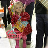 Emma Perry, 2, of Haverhill helped mom shop while at the Toy Fair at the Tospfield Fair Grounds Saturday morning. Photo by Deborah Parker/November 14, 2009