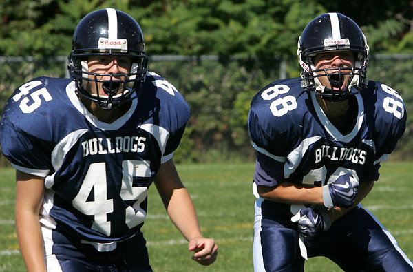 North Shore Tech's Chris Sudak and Pat Wood celebrate after the Tech gained control of the ball after a fumble by Bristol-Plymouth during Saturday's game held at Barry Field in Middleton. Photo by Deborah Parker/September 19, 2009