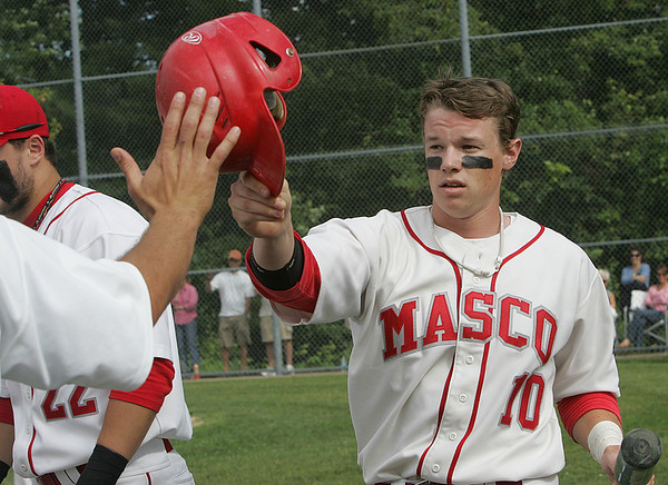 Masco's Colin Shepard is congratulated by team mates after crossing home plate during Monday's Division 2 North quarterfinal's state tournament game against Wilmington held in Topsfield. Photo by Deborah Parker/June 7, 2010