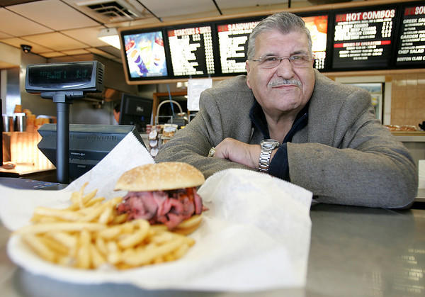 Nondas Lagonakis, owner of Bill and Bob's Roast Beef, stands behind the counter with a plate of the restaurant's famous roast beef sandwhich. The restaurant will be celebrating 40 years in business. Photo by Deborah Parker/November 4, 2009