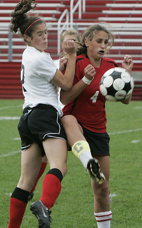 Marblehead: Salem's Monique Gallants blocks the ball from Marblehead's Kathryn DiGiammarind during yesterday's game at Marblehead.<br /> Photo by Deborah Parker/Salem News Friday, October 03, 2008
