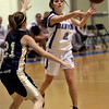 Danvers: Danvers' Erica Veilleux passes the ball in front of the hoop during yesterday's game against Winthrop held at Danvers High School. Photo by Deborah Parker/Salem News Friday, February 6, 2009.