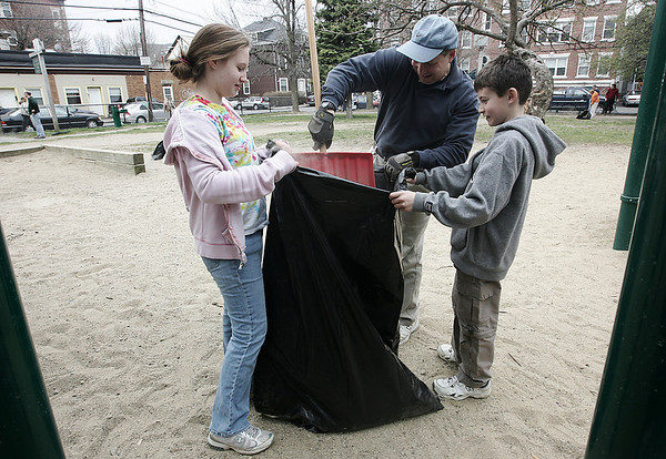 Salem: Salem Rotary Club president David Wescott, and his two children, Jaclyn and Eric helped to clean up Mary Jane Lee Park in Salem with other Rotary volunteers Saturday morning. Photo by Deborah Parker/Salem News April 18, 2009.