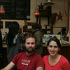 Andy and Jackie King, owners of A&J King Artisan Bakers, sit in the bakery's cafe area on a busy afternoon. The bakery is expanding to create a bigger pastry area, redo the retail space and is adding a small office. Photo by Deborah Parker/August 24, 2010