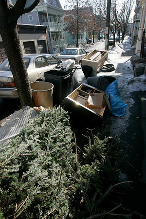 Salem: A pile of trash, furniture and a christmas tree were left on the corner of Palmer and Salem Streets in Salem.  Photo by Deborah Parker/Salem News Wednesday, February 11, 2009.