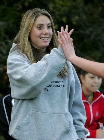 Injured player Lexi Dussi high fives a teammate while on the sidelines during Tuesday's game at Masconomet against Manchester Essex. Lexi is going to one of the country's strongest Division 2 programs to continue her soccer career.  Photo by Deborah Parker/October 20, 2009
