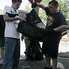 Kyle O'Connor, 14, and Jacob Ashton, 15, both of Beverly help to clean up a pile of leaves and dirt on Mill Street as part of the Gloucester Crossing cleanup day on Saturday. Photo by Deborah Parker/May 30, 2009