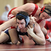 Topsfield: Masconomet's Steve Perkins wrestles with Hamilton-Wenham's Dylan Baker in the 152lb heat during Saturday's meet held at Masconomet. Photo by Deborah Parker/Salem News Saturday, January 24, 2009.