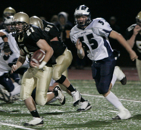 Peabody: Bishop Fenwick's Tyler Hurst is chased down the field by Swampscott's #55 (there was no roster) during yesterday's game at Fenwick. Photo by Deborah Parker/Salem News Friday, October 17, 2008.