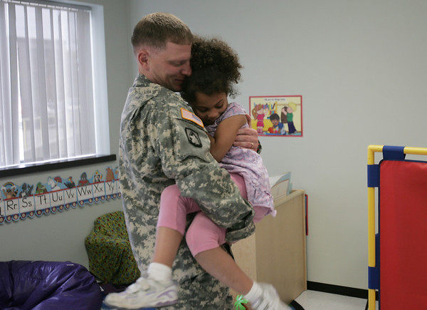 Soldier Brandon Russell hugs his daugther Rhema, 6, after surprising her at school upon returning from a 15 month tour of duty in Iraq Thursday afternoon. photo by deborah parker/october 28, 2010