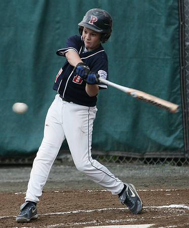 Peabody West's AJ DiFillipo takes a swing while at bat against North Andover during Friday night's game held at Wyoma Field in Lynn. Photo by Deborah Parker/July 24, 2009