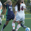 Endicott's Kayla Plante is defended by Salem State's Lauren Kilduff during yesterday's game held at Alumni Field at Salem State University in Salem. Photo by Deborah Parker/September 1, 2010