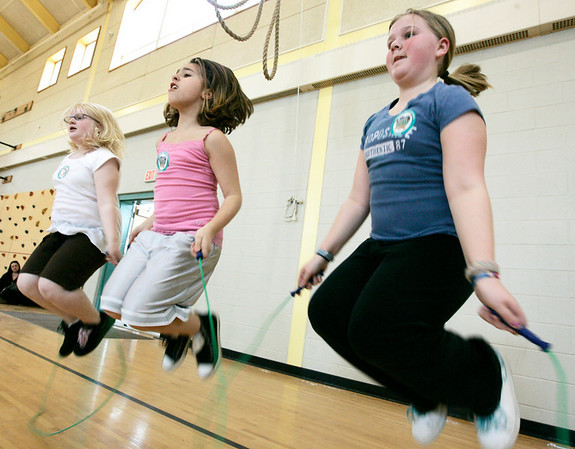 Peabody: Fifth grade classmates from the Captian Samuel Brown School, from left, Natalie Johnson, Dena De'Angelico and Melissa Neary, try to jump rope together while participating in the American Heart Association's Jump Rope for Heart program Wednesday afternoon. The program helps to raise money for the Association and this is the sixth year that the school has participated. Photo by Deborah Parker/Salem News Wednesday March 18, 2009.