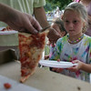 Josephine Ginivisian, 6, of Marblehead eyes a piece of pizza during the Heritage Days Pizza Competition held at the Salem Common Monday evening. Photo by Deborah Parker/August 9, 2010