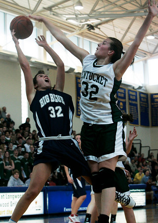 Boston: Swampscott's Kara Gilberg is defended in front of the hoop by Pentucket's Kirsten Daamen during the Division 3 Final game Saturday at Emmanuel College. Photo by Deborah Parker/Salem News Saturday March 7, 2009.