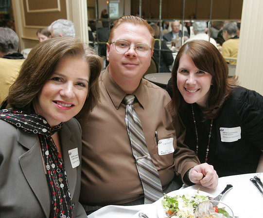 From left, LeeAnne Powers, Frederick Dupuis and Rebecca Hutchings, all of NMTW Community Credity Union, attend the North Shore Chamber of Commerce Business Expo held at the Crowne Plaza Boston North Shore. Photo by Deborah Parker/February ,23, 2010