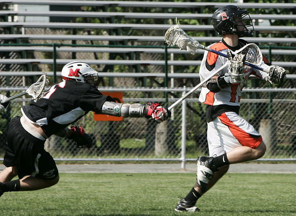 Beverly: Marblehead's Jess Libkind hacks at Beverly's Brian Nolan knocking the ball loose during yesterday's game held at Hurd Stadium. Photo by Deborah Parker/May 15, 2009
