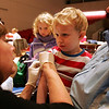 Alexis Earp 6, of Salem watches as her brother Tyler Earp, 3, of Salem receives an H1N1 vacination from M.J. Duffy-Alexander, the public health nurse for Lynn, during a clinic at Salem High School Wednesday evening. The clinic was held for children 18 months to 18 and was also available for pregnant women and caretakers of babies. Tyler is sitting on mom, Julie's, lap. Photo by Deborah Parker/December 9, 2009