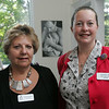 Carol Gorevitz of North Shore Career Center and Jennifer Bell, Salem Main Streets Manager, attend Coffee Connection, a Salem Chamber of Commerce event, held at Kim Indresano Photography in downtown Salem Thursday morning. Photo by Deborah Parker/July 8, 2010