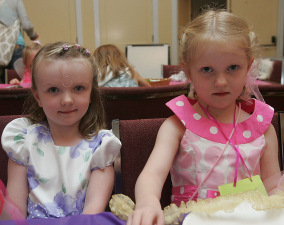 Margaret and Claire Turpel, 4, of Ipswich, attend the Fancy Nancy Soiree at the Wenham Museum, Tuesday afternoon. Attendees were read a Fancy Nancy story, created a fancy craft and were treated to ice cream. Photo by Deborah Parker/August 24, 2010