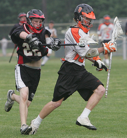 Beverly's Brendan Crowley is defended by Whitman Hanson Regional's Conor Graves during yesterday's East Division 2 preliminary round game held at Hurd Stadium in Beverly. Photo by Deborah Parker/June 2, 2010