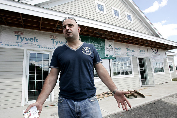 """Thodori Londi talks about the opening of two new businesses, """"Londi's Famous Roast Beef"""" and """"Salon Couture"""" at the site of the Danversport Bakery nearly three years after the explosion. Photo by Deborah Parker/September 15, 2009"""